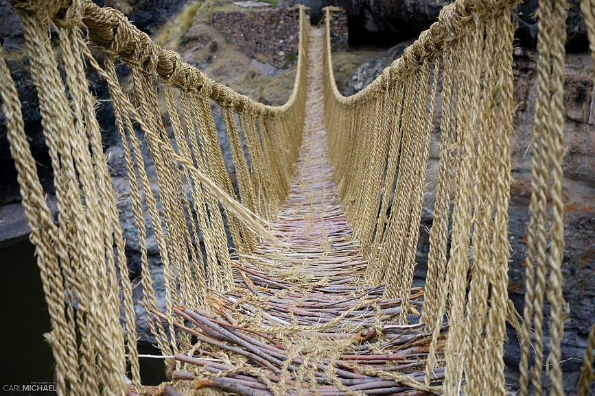 Stepping out onto Q'eswachaka rope bridge