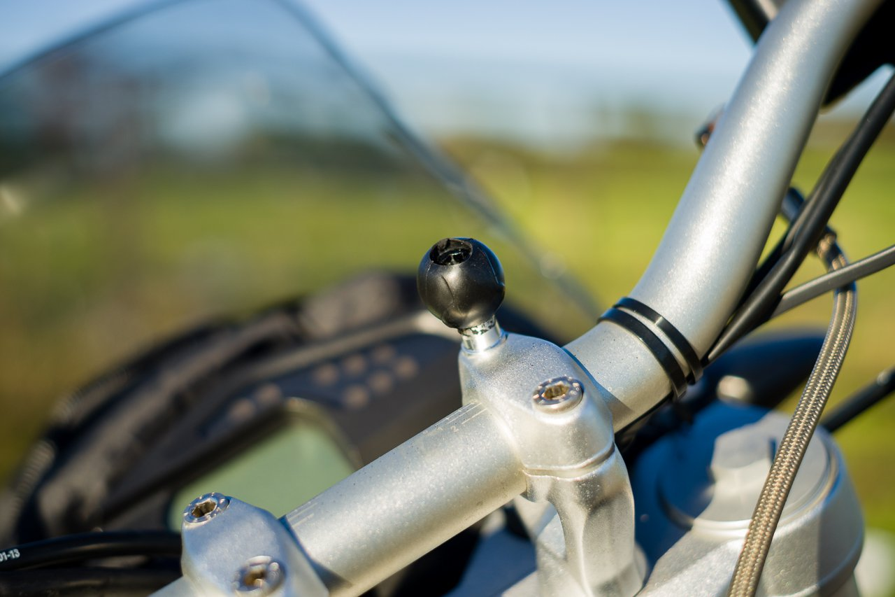 "1"" Ram Mount ball attached to handlebar clamp"