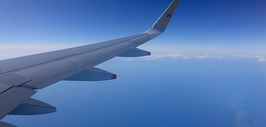 The wing of a Monarch jet