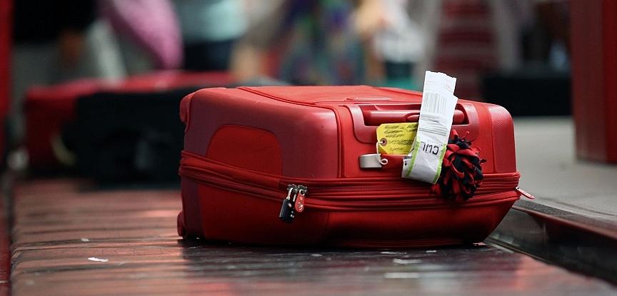 lost property - suitcase on conveyor belt